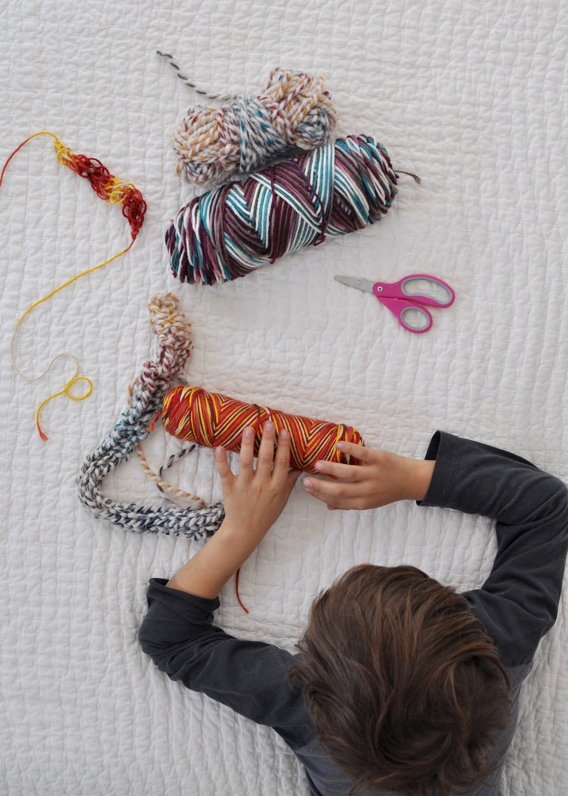 Montessori-Inspired: Finger-Knitting with Oliver